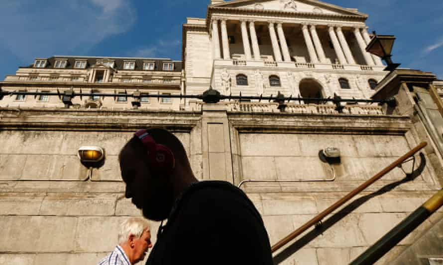 Pedestrians pass on a set of stairs outside the Bank of England
