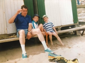 Taken on a family holiday in Swanage, Alistair (right), sits on a bench by the beach with his brother Tim and dad.