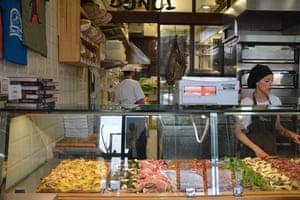 Pizza al taglio at Gabriele Bonci with its 'impeccable dough and fine toppings'.