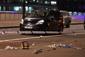 Debris and abandoned cars remain at the scene on London Bridge.