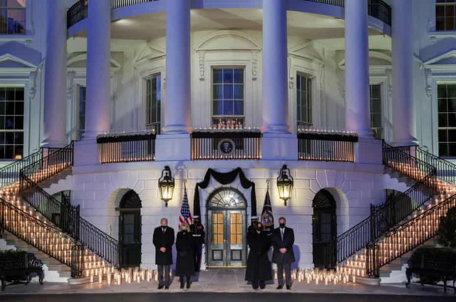 Joe Biden, Jill Biden, Kamala Harris and Doug Emhoff attend a moment of silence and candle lighting ceremony at the White House.