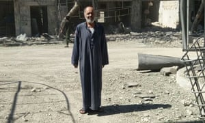 Abo Awad a taxi driver in eastern Aleppo