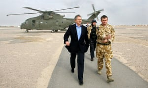 Tony Blair arriving at Basra airport in Iraq in December 2004 for meetings with senior military officers.