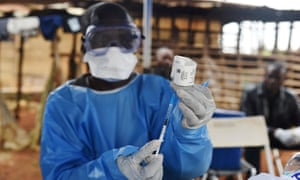 A Congolese health worker prepares to administer an Ebola vaccine
