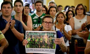 People attend a mass in memoriam of the players of the Brazilian team Chapecoense Real killed in a plane crash in the Colombian mountains, in Chapeco, Santa Catarina, on Tuesday.