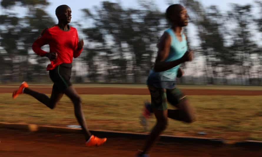 Athletes exercise in the early morning in the sports ground of the University of Eldoret in western Kenya.