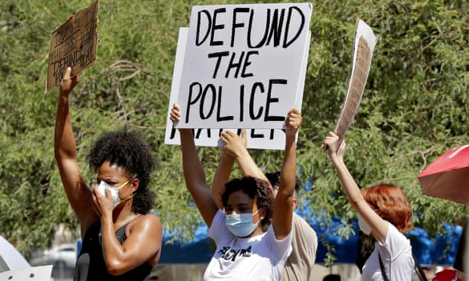 Protesters rally in Phoenix, demanding the city council defund the Phoenix police department on 3 June 2020.
