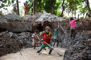Mathias Mbelle, 13, at work in a small mining operation in a remote western area of Central African Republic. Such children are unprotected from measles and other preventable diseases