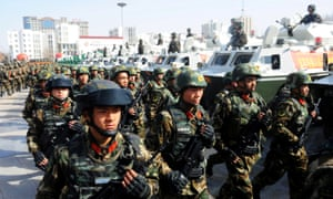 Paramilitary policemen stand in formation as they take part in an anti-terrorism oath-taking rally, in Kashgar, Xinjiang Uighur Autonomous Region, China, in 2017.