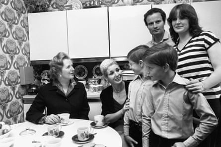Margaret Thatcher, left, with the Patterson family, the first people to purchase their council house under the Right to Buy scheme in 1980.