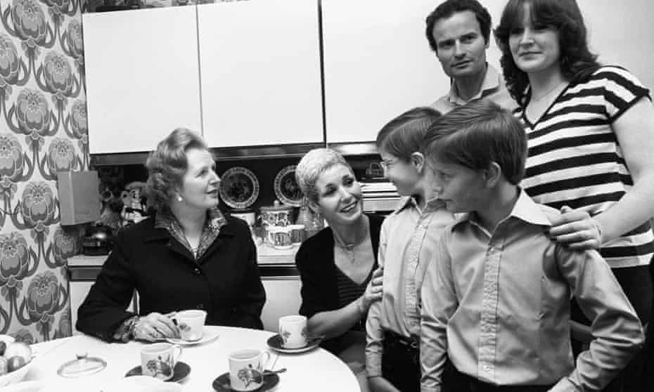 Margaret Thatcher with a family who had bought their council house in Harold Hill in 1980