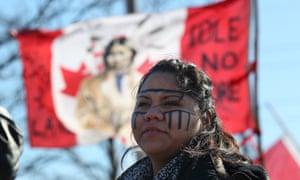 """Tayah Doxtator watch traffic as """"Idle no more"""" protesters rally at the base of the Ambassador Bridge between Windsor and the United States."""
