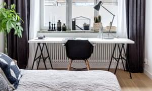 Desk by window in bedroom