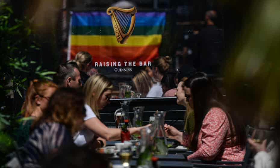 People eating outdoors in Dublin this month. Irish cafes and restaurants were due to resume indoor service on 5 July.