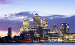 The London skyline with Canary Wharf skyscrapers at dawn.