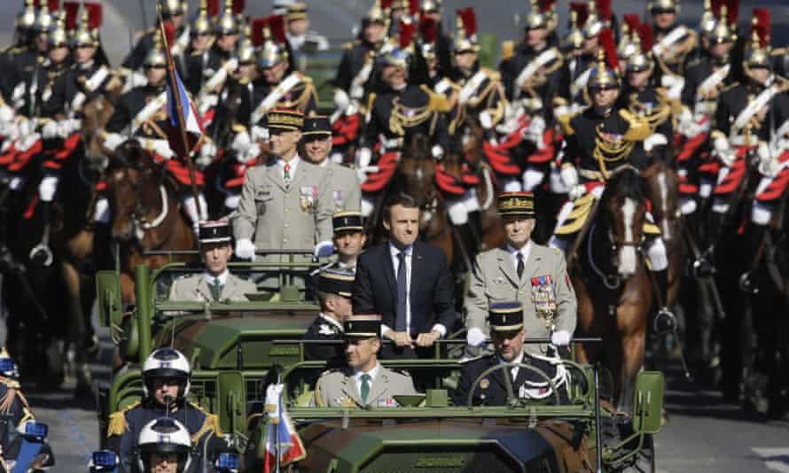 Emmanuel Macron is driven down the Champs Élysées