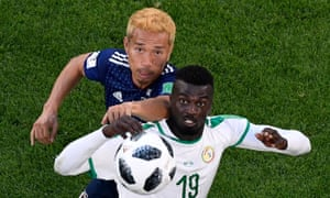 Japan's Yuto Nagatomo vies with Senegal's Mbaye Niang during the 2-2 draw in Group H at the Ekaterinburg Arena.