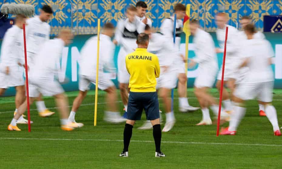 Ukraine coach Andriy Shevchenko watches his players during training