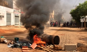 Protesters block a road in Khartoum, Sudan