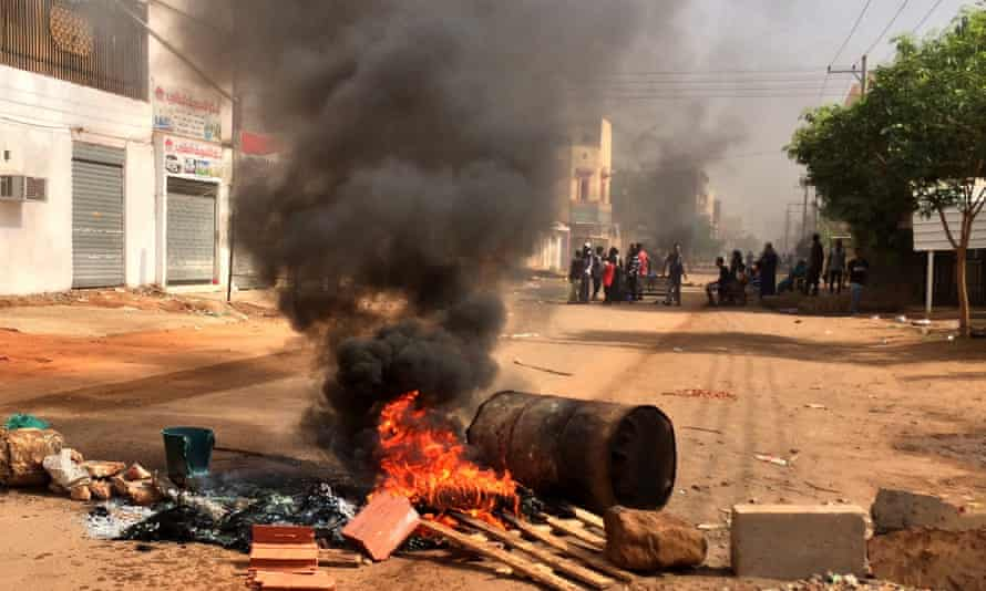 Protesters block a road in Khartoum, Sudan