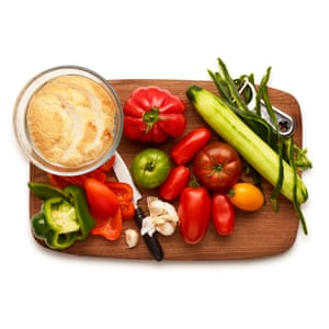 Assemble crusty breadcrumbs, green peppers, cucumber, garlic and the ripest tomatoes and red peppers you can find.