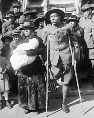 A wounded black US soldier attends a victory parade in New York in 1919.