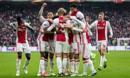 Ajax celebrate their second goal against Lyon in the first leg of the Europa League semi-final.