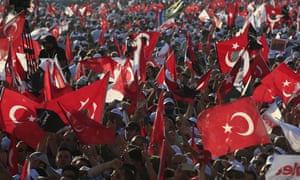 Supporters of Kemal Kilicdaroglu, the leader of Turkey's main opposition Republican People's Party, hold Turkish flags in Istanbul at the rally.