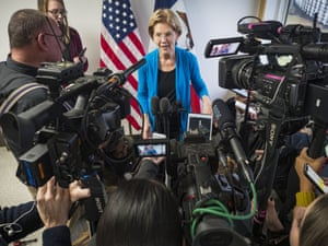 Elizabeth Warrentalks to reporters during a press gaggle after a campaign event in Iowa.