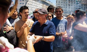 A man gives away choripanes as part of a protest against the ban on food carts near soccer venues in February 2019 in Buenos Aires.