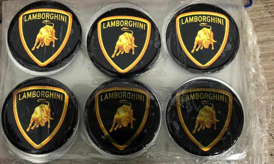 Emblem badges stamped with the Lamborghini logo, inside the workshop in Itajai, Brazil.