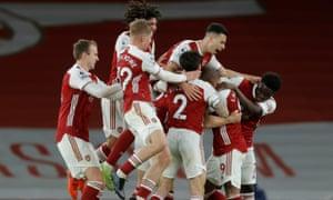 Arsenal's Granit Xhaka celebrates scoring their second goal with teammates.