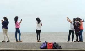 Young people take selfies on Mumbai's Marine Drive, one of the spots cited as dangerous.