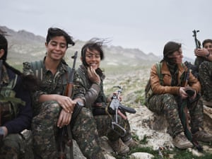 Fighters of the YJÊ gather outside their base for military training.