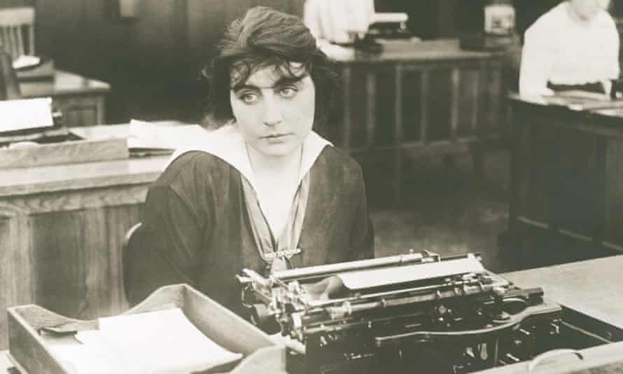 woman typing at desk
