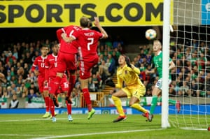 Luxembourg's Kevin Malget scores an own goal to give Northern Ireland the lead.
