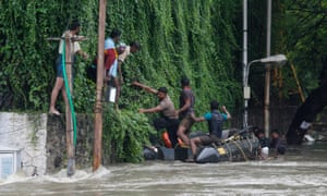 People are rescued from floodwaters in Chennai