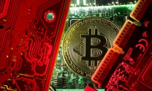 Bitcoin standing on PC motherboard.