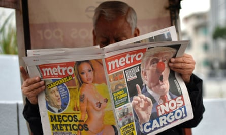A Mexican man reads a paper emblazoned with news on Donald Trump.