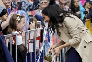 Meghan, Duchess of Sussex meets a young girl on her arrival at the Royal Botanic Gardens in Melbourne, Australia