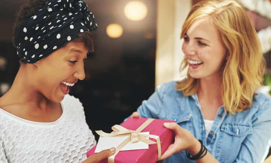 Woman giving present to another