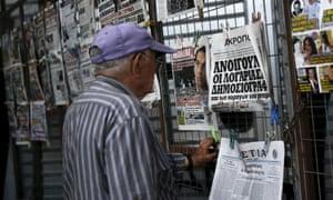 Greek man reading newspaper
