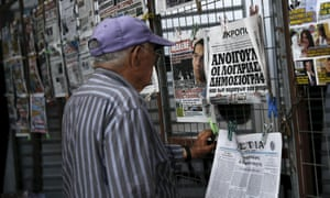 A man reads a newspaper front page bearing a picture of Greek Prime Minister Alexis Tsipras in Athens June 18, 2015. Hopes of a breakthrough at Thursday's gathering of European finance ministers, once seen as the last opportunity for an agreement, looked increasingly remote. REUTERS/Alkis Konstantinidis