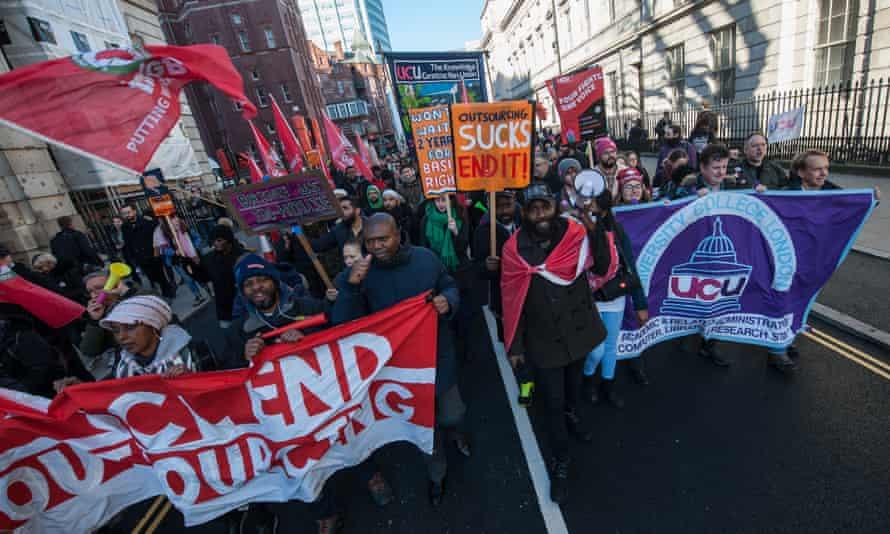 Striking university staff march through London