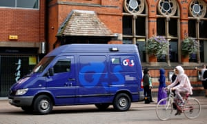 A G4S security van is parked outside a bank in Loughborough, central England