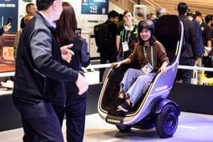 A visitor tries the Segway 'S-Pod' motorized chair