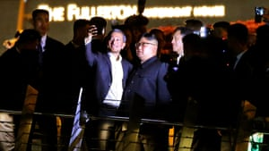 Kim takes a night-time stroll around some of Singapore's sights and take a selfie with Singapore Foreign Minister Vivian Balakrishnan on the Jubilee bridge at the Esplanade