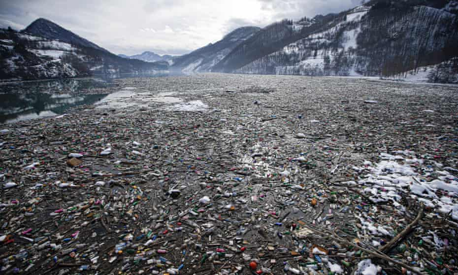 Plastic bottles and other garbage floats in the Potpecko lake near Priboj, in southwest Serbia, January 2021.