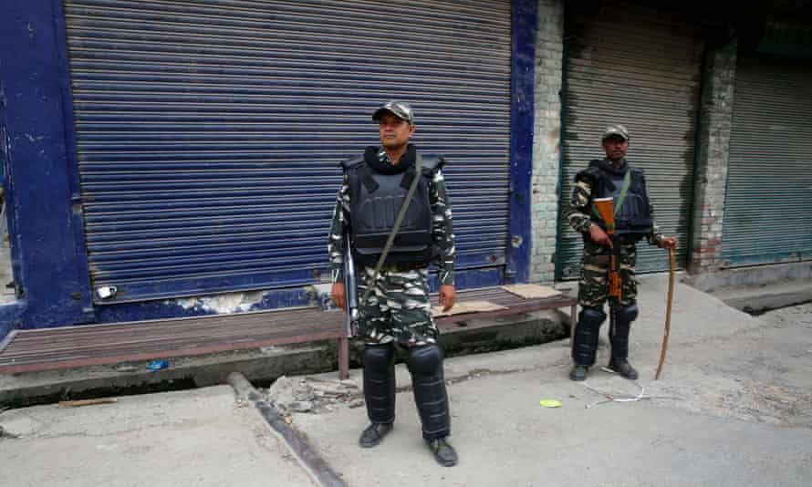 Indian paramilitary soldiers stand guard near a closed market in Srinagar on Tuesday.