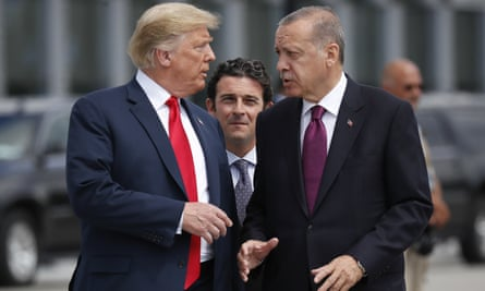 Donald Trump speaks with Turkish president Recep Tayyip Erdoğan as they arrive at a summit at Nato headquarters in Brussels on 11 July.